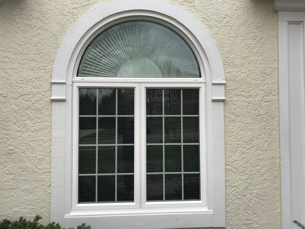 Twin casement window with halfround window